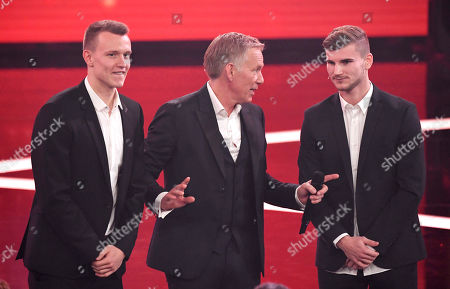 "Stock Photo of Entertainer Johannes B. Kerner, center, talks to soccer player Timo Werner, right, during the charity gala ""Ein Herz fuer Kinder"" (a heart for children) in Berlin, Germany"