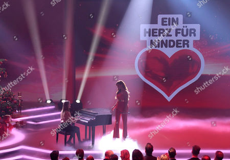 "Stock Photo of Singer Andrea Berg, right, performs during the charity gala ""Ein Herz fuer Kinder"" (a heart for children) in Berlin, Germany"