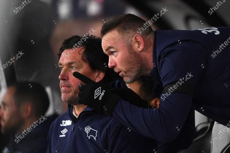 11th December 2019, Pride Park Stadium, Derby, England; Sky Bet Championship, Derby County v Sheffield Wednesday : Derby County Player-Coach Wayne Rooney give his thoughts to Assistant Manager, Chris van der Weerden