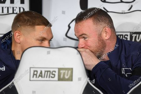 11th December 2019, Pride Park Stadium, Derby, England; Sky Bet Championship, Derby County v Sheffield Wednesday : Derby County Player-Coach Wayne Rooney hides his mouth from the photographers while talking with Martyn Waghorn (9) of Derby County 