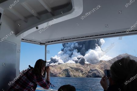 An image provided by visitor Michael Schade shows White Island (Whakaari) volcano, as it erupts, in the Bay of Plenty, New Zealand, 09 December 2019. According to police, at least five people have died in the volcanic erruption at around 2:11 pm local time on 09 December. The island is located around 40km offshore of the Bay of Plenty.