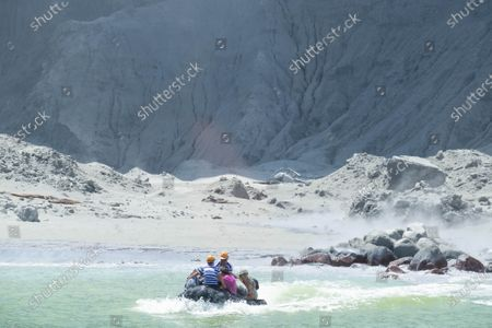 An image provided by visitor Michael Schade shows tourists on a boat fleeing White Island (Whakaari) volcano, as it erupts, in the Bay of Plenty, New Zealand, 09 December 2019. According to police, at least five people have died in the volcanic erruption at around 2:11 pm local time on 09 December. The island is located around 40km offshore of the Bay of Plenty.