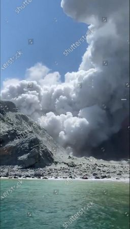 Stock Picture of An image provided by visitor Michael Schade shows White Island (Whakaari) volcano, as it erupts, in the Bay of Plenty, New Zealand, 09 December 2019. According to police, at least five people have died in the volcanic erruption at around 2:11 pm local time on 09 December. The island is located around 40km offshore of the Bay of Plenty.