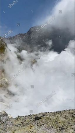 Stock Photo of An image provided by visitor Michael Schade shows White Island (Whakaari) volcano, shortly before erupting, in the Bay of Plenty, New Zealand, 09 December 2019. According to police, at least five people have died in the volcanic erruption at around 2:11 pm local time on 09 December. The island is located around 40km offshore of the Bay of Plenty.