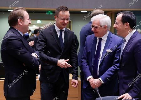 (L-R) European Commissioner in charge of neighborhood and enlargement policy, Hungarian Olivrer Varhelyi; Hungarian Minister of Foreign Affairs and Trade Peter Szijjarto; Polish Foreign Minister Jacek Czaputowicz and Cyprus' Minister of Foreign Affairs Nikos Christodoulides at the start of an EU Foreign Affairs Council (FAC) in Brussels, Belgium, 09 December 2019. European High Representative of the Union for Foreign Affairs, Spanish, Josep Borrell is chairing his first Foreign Affairs Ministers meeting.