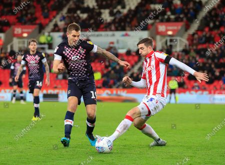 10th December 2019, Bet365 Stadium, Stoke-on-Trent, England; Sky Bet Championship, Stoke City v Luton Town : James Collins (19) of Luton Town and Stephen Ward (3) of Stoke City challenge for the ball