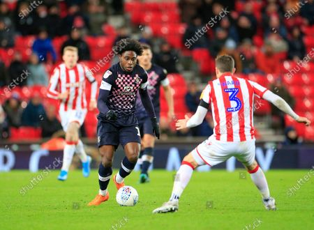 10th December 2019, Bet365 Stadium, Stoke-on-Trent, England; Sky Bet Championship, Stoke City v Luton Town : Pelly Ruddock (17) of Luton Town is confronted by Stephen Ward (3) of Stoke City