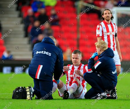 10th December 2019, Bet365 Stadium, Stoke-on-Trent, England; Sky Bet Championship, Stoke City v Luton Town : Ryan Shawcross (17) of Stoke City goes down after a challenge