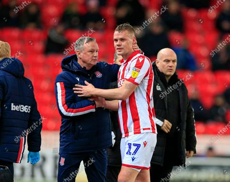 10th December 2019, Bet365 Stadium, Stoke-on-Trent, England; Sky Bet Championship, Stoke City v Luton Town : Ryan Shawcross (17) of Stoke City is consoled by his manager Michael OÕNeill after having to be substituted in the 15th minute