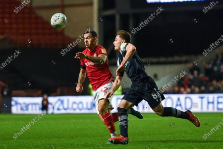 Stock Photo of 10th December 2019, Ashton Gate, Bristol, England; Sky Bet Championship, Bristol City v Millwall : Pedro Pereira (32) of Bristol City and Ben Thompson (08) of Millwall both looking to win the ballCredit: Gareth Dalley/News Images
