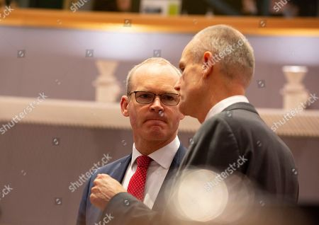 Irish Foreign Minister Simon Coveney, left, speaks with Dutch Foreign Minister Stef Blok during a meeting of EU foreign ministers at the Europa building in Brussels, . European Union foreign ministers are debating how to respond to a controversial deal between Turkey and Libya that could give Ankara access to a contested economic zone across the Mediterranean Sea