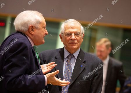 Spanish State Secretary for Foreign Affairs Fernando Valenzuela Marzo, left, speaks with European Union foreign policy chief Josep Borrell during a meeting of EU foreign ministers at the Europa building in Brussels, . European Union foreign ministers are debating how to respond to a controversial deal between Turkey and Libya that could give Ankara access to a contested economic zone across the Mediterranean Sea
