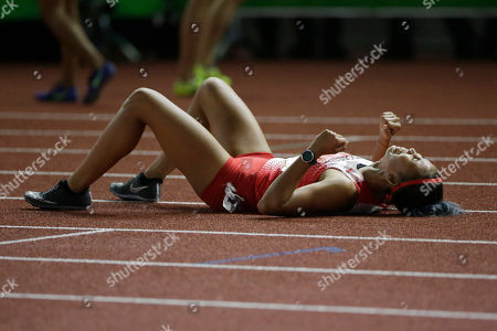 Indonesia's Emilia Nova celebrates after winning in the women's 100m hurdles final during the athletics competition at the 30th Southeast Asian Games at Athletics Stadium in New Clark City, Tarlac province, northern Philippines on