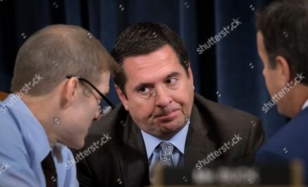 Jim Jordan, Devin Nunes, John Ratcliffe. Rep. Jim Jordan, R-Ohio, Rep. Devin Nunes, R-Calif, the ranking member of the House Intelligence Committee, and Rep. John Ratcliffe, R-Texas, talk during break as the House Judiciary Committee considers the investigative findings in the impeachment inquiry against President Donald Trump, on Capitol Hill in Washington