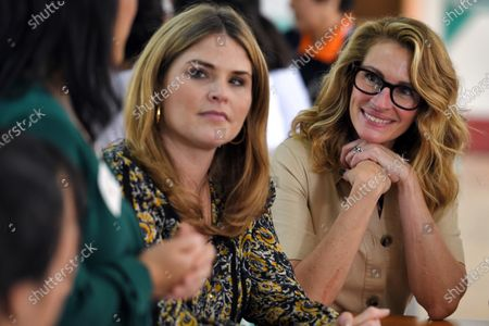 Jenna Bush Hager (C), daughter of former US president George W. Bush, and US actress Julia Roberts (R) smile as they meet with Vietnamese students in Can Giuoc district, Long An province, Vietnam 09 December 2019. Michelle Obama and Jenna Bush Hager were joined by Julia Roberts in Vietnam to promote girls' education, ahead of their visit to Malaysia for the Obama Foundation's Leaders: Asia-Pacific Program conference.