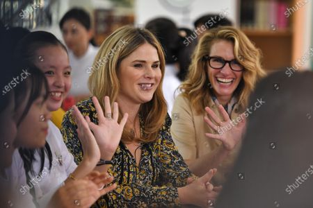 Stock Image of Jenna Bush Hager (C), daughter of former US president George W. Bush, and US actress Julia Roberts (R) smile as they meet with Vietnamese students in Can Giuoc district, Long An province, Vietnam 09 December 2019. Michelle Obama and Jenna Bush Hager were joined by Julia Roberts in Vietnam to promote girls' education, ahead of their visit to Malaysia for the Obama Foundation's Leaders: Asia-Pacific Program conference.