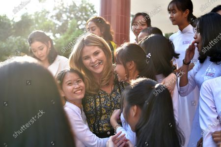 Stock Picture of Jenna Bush Hager (C), daughter of former US president George W. Bush, smiles as she poses for a photo with Vietnamese students in Can Giuoc district, Long An province, Vietnam 09 December 2019. Michelle Obama and Jenna Bush Hager were joined by Julia Roberts in Vietnam to promote girls' education, ahead of their visit to Malaysia for the Obama Foundation's Leaders: Asia-Pacific Program conference.