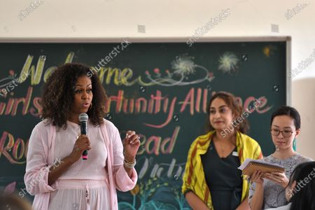 Stock Photo of Former US first lady Michelle Obama (L) meets wiith Vietnamese students in Can Giuoc district, Long An province, Vietnam 09 December 2019. Michelle Obama and Jenna Bush Hager, daughter of former US president George W. Bush, were joined by Julia Roberts in Vietnam to promote girls' education, ahead of their visit to Malaysia for the Obama Foundation's Leaders: Asia-Pacific Program conference.