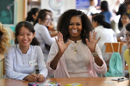 Former US first lady Michelle Obama (C) smiles as she meets wiith Vietnamese students in Can Giuoc district, Long An province, Vietnam 09 December 2019. Michelle Obama and Jenna Bush Hager, daughter of former US president George W. Bush, were joined by Julia Roberts in Vietnam to promote girls' education, ahead of their visit to Malaysia for the Obama Foundation's Leaders: Asia-Pacific Program conference.