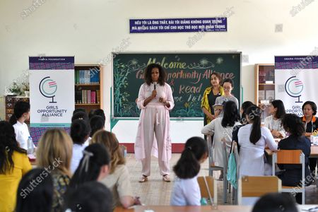 Former US first lady Michelle Obama (C) meets wiith Vietnamese students in Can Giuoc district, Long An province, Vietnam 09 December 2019. Michelle Obama and Jenna Bush Hager, daughter of former US president George W. Bush, were joined by Julia Roberts in Vietnam to promote girls' education, ahead of their visit to Malaysia for the Obama Foundation's Leaders: Asia-Pacific Program conference.