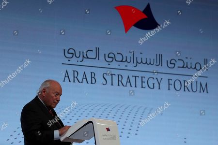 """Former U.S. Vice President Dick Cheney talks to the audience at the Arab Strategy Forum in Dubai, United Arab Emirates, . Cheney warned Monday that """"American disengagement"""" in the Middle East will benefit only Iran and Russia, indirectly criticizing President Donald Trump's pledges to pull forces out of the region"""