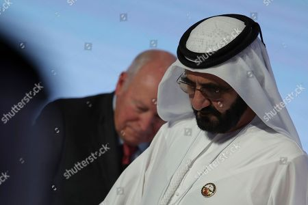"""Stock Picture of Sheikh Mohammed bin Rashid Al Maktoum, Dubai Ruler and UAE Prime Minister, right, leaves after the speech of Former U.S. Vice President Dick Cheney at the Arab Strategy Forum in Dubai, United Arab Emirates, . Dubai's ruler, Sheikh Mohammed bin Rashid Al Maktoum, attended the talk by Cheney, showing the respect still afforded to the 78-year-old former vice president. Cheney made a point himself to describe the UAE as """"confident, forward-looking influence in the Middle East"""