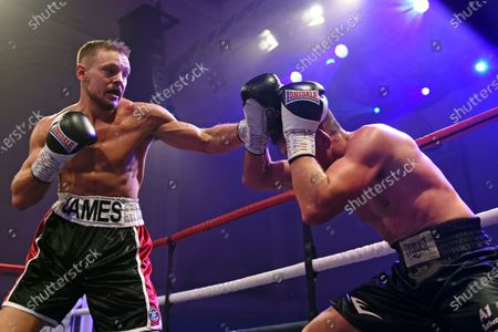 Stock Photo of Scott James (black/white shorts) defeats Liam Griffiths during a Boxing Show at the Corn Exchange on 8th December 2019