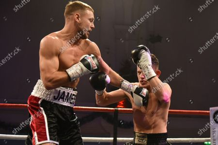 Scott James (black/white shorts) defeats Liam Griffiths during a Boxing Show at the Corn Exchange on 8th December 2019