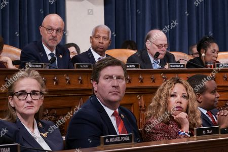 Stock Image of Madeleine Dean, Greg Stanton, Lucy McBath, Joe Neguse, Ted Deutch, Hank Johnson, Steve Cohen, Sheila Jackson Lee. Democrats on the House Judiciary Committee listen as the panel considers the investigative findings in the impeachment inquiry against President Donald Trump, on Capitol Hill in Washington,. From left on bottom row are, Rep. Madeleine Dean, D-Pa., Rep. Greg Stanton, D-Ariz., Rep. Lucy McBath, D-Ga., and Rep. Joe Neguse, D-Colo. Top row from left are, Rep. Ted Deutch, D-Fla., Rep. Hank Johnson, D-Ga., Rep. Steve Cohen, D-Tenn., Rep. Sheila Jackson Lee, D-Texas