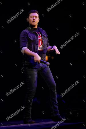 Scotty McCreery performs during the US99 Stars and Strings concert at the Allstate Arena, in Rosemont