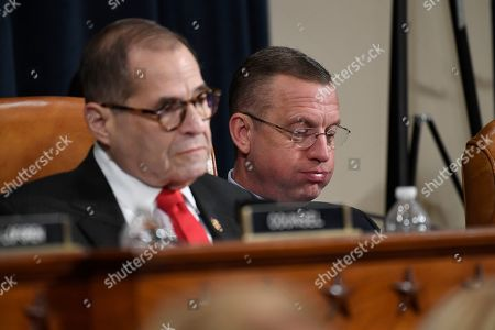 House Judiciary Committee ranking member Rep. Doug Collins, R-Ga., right, and House Judiciary Committee Chairman Rep. Jerrold Nadler, D-N.Y., left, listen as Democratic staff attorney Daniel Goldman and Republican staff attorney Steve Castor testify as the House Judiciary Committee hears investigative findings in the impeachment inquiry of President Donald Trump, on Capitol Hill in Washington