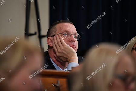 House Judiciary Committee ranking member Rep. Doug Collins, R-Ga., listens as Democratic staff attorney Daniel Goldman and Republican staff attorney Steve Castor testify as the House Judiciary Committee hears investigative findings in the impeachment inquiry of President Donald Trump, on Capitol Hill in Washington