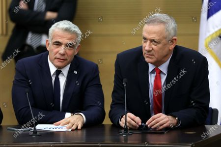 Leader of the Blue and White Party Benny Gantz (R) and Member of the Knesset Yair Lapid (L) during faction meeting of the Blue and White party at the Israeli Knesset (parliament) in Jerusalem, Israel, 09 December 2019. Media reports state the Blue and White Party announced Gantz will run as party's candidate for prime minister if a third elections was decided as talks between the Likud Party and the Blue and White Party to form a unity government continue without any solution to the political crisis.