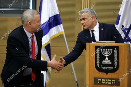 Leader of the Blue and White Party Benny Gantz (L) and Member of the Knesset Yair Lapid (R) shake hands during faction meeting of the Blue and White party at the Israeli Knesset (parliament) in Jerusalem, Israel, 09 December 2019. Media reports state the Blue and White Party announced Gantz will run as party's candidate for prime minister if a third elections was decided as talks between the Likud Party and the Blue and White Party to form a unity government continue without any solution to the political crisis.
