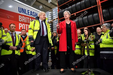 Stock Picture of Chair of the Vote Leave Gisela Stuart, right, standing next to Britain's Prime Minister Boris Johnson speaks during a question and answer session, part of a General Election campaign visit to Ferguson's Transport in Washington, England, . Britain goes to the polls on Dec. 12