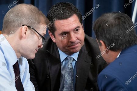 Republican Representative from California and ranking member of the House Permanent Select Committee on Intelligence Devin Nunes (C), Republican Representative from Ohio Jim Jordan (L) and Republican Representative from Texas John Ratcliffe (R) speak with one another during a break in the House Judiciary Committee hearing 'Counsel Presentations of Evidence in the Impeachment Inquiry of President Donald Trump ' on Capitol Hill in Washington, DC, USA, 09 December 2019. The committee is hearing evidence from the House Judiciary Committee and the House Permanent Select Committee on Intelligence staff lawyers of both parties as it considers whether President Trump's actions rise to the level of impeachable offenses.