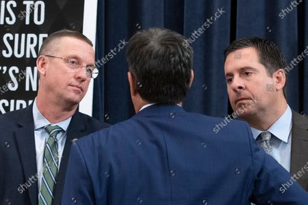 Republican Representative from California and ranking member of the House Permanent Select Committee on Intelligence Devin Nunes (R), Republican Representative from Georgia Doug Collins (L) and Republican Representative from Texas John Ratcliffe (C) speak with one another during a break in the House Judiciary Committee hearing 'Counsel Presentations of Evidence in the Impeachment Inquiry of President Donald Trump ' on Capitol Hill in Washington, DC, USA, 09 December 2019. The committee is hearing evidence from the House Judiciary Committee and the House Permanent Select Committee on Intelligence staff lawyers of both parties as it considers whether President Trump's actions rise to the level of impeachable offenses.