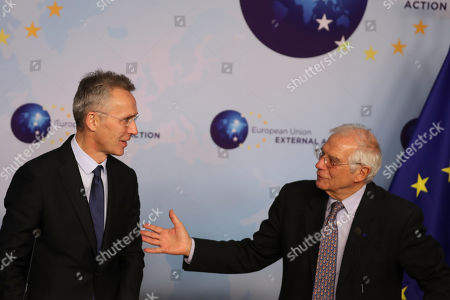 Stock Image of Jens Stoltenberg, Josep Borrell. NATO Secretary General Jens Stoltenberg, left, and European Union foreign policy chief Josep Borrell give a joint statement following their meeting in Brussels