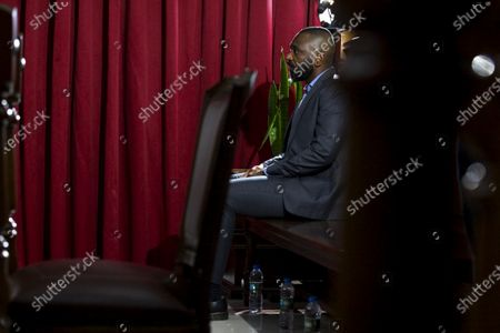 Stock Image of The former president of the Sovereign Fund of Angola, Jose Filomeno 'Zenu' dos Santos, son of Angola's former President Jose Eduardo dos Santos, waits for the beginning of his trial for embezzlement and money laundering at the Supreme Court Criminal Chamber in Luanda, Angola, 09 December 2019. The trial , in which the former governor of the National Bank of Angola (BNA), Valter Filipe (unseen), is also accused, originally was scheduled for earlier this September but reportedly was postponed at request of the former BNA governor's lawyer.