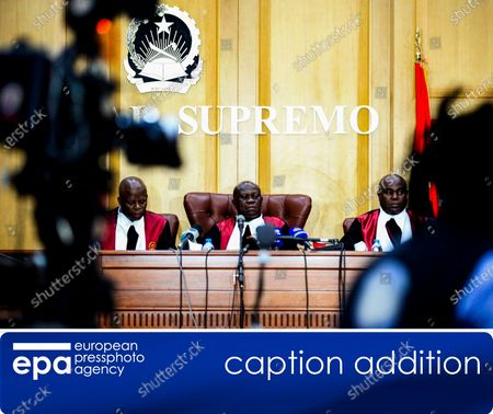 Stock Picture of (CAPTION ADDITION) - This is to add the presiding judge's name as additional information to image epa08057881 issued 09 December 2019:    Presiding judge Joao da Cruz Pitra (C) and two colleagues take their seats at the beginning of the trial for embezzlement and money laundering of the former president of the Sovereign Fund of Angola, Jose Filomeno 'Zenu' dos Santos, the son of Angola's former President Jose Eduardo dos Santos, and the former governor of the National Bank of Angola (BNA), Valter Filipe (both unseen), at the Supreme Court Criminal Chamber in Luanda, Angola, 09 December 2019. The trial which originally was scheduled for earlier this September was reportedly postponed at request of the former BNA governor's lawyer.