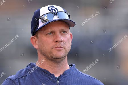San Diego Padres' Andy Green looks on before a baseball game against the Boston Red Sox, in San Diego. The Chicago Cubs named former San Diego Padres manager Andy Green as bench coach