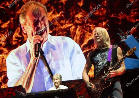 Keyboardist Don Airey (L) and guitarist Steve Morse perform in front of a projected image of singer Ian Gillan during the concert of the British rock band Deep Purple in Papp Laszlo Budapest Sports Arena in Budapest, Hungary, 09 December 2019.