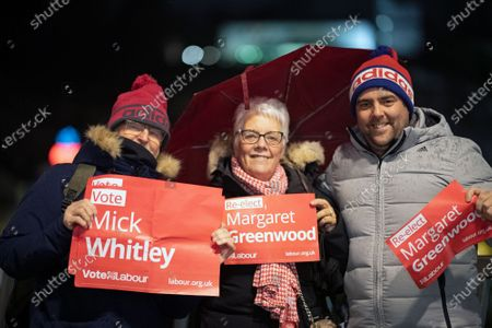 English tourists display election campaign banners of former MP Margaret Greenwood and Mick Whitley, candidate for Birkenhead, of Britain's opposition Labour Party in Salzburg, Austria, 09 December 2019. Britons go to the polls on 12 December in a general election.