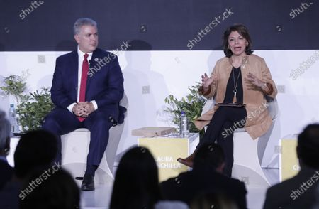 Stock Image of President of Colombia Ivan Duque (L) and the former President of Costa Rica Laura Chinchilla (R) take part in the presentation of the 'Human Development Report 2019' of the United Nations Development Program (UNDP), in Bogota, Colombia, 09 December 2019. Colombian President Ivan Duque announced that he will sign this week the Escazu Agreement, which seeks to improve human rights and environmental protection in Latin America and the Caribbean.