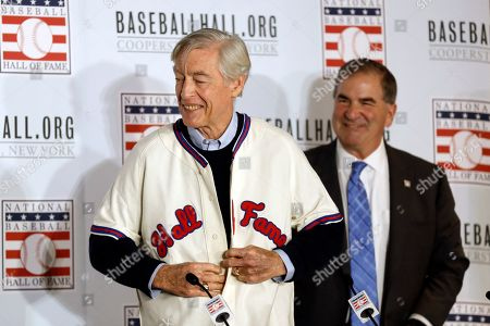 Stock Photo of Former St. Louis Cardinals catcher Ted Simmons buttons a Hall of Fame jersey as National Baseball Hall of Fame President Tim Mead looks, right, during the Major League Baseball winter meetings, in San Diego. Simmons was elected into the Hall of Fame Sunday