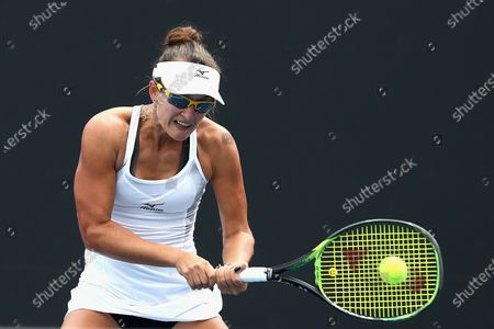 Stock Photo of Arina Rodionova of Australia plays a backhand in her singles match against Sara Tomic of Australia during the Australian Open 2020 Play-off at Melbourne Park in Melbourne, Australia, 10 December 2019.