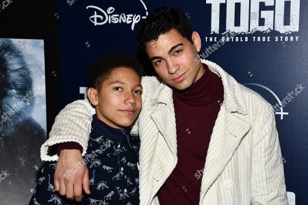 "Stock Image of Davi Santos, Gabriel Fulgencio. Gabriel Fulgencio, left, and Davi Santos attend a screening of ""Togo"", hosted by Disney Plus and The Cinema Society, at iPic Theater, in New York"