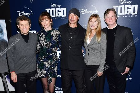 "Stock Image of Willem Dafoe, Julianne Nicholson, Ericson Core, Tom Flynn, Kim Zubick. Willem Dafoe, left, Julianne Nicholson, Ericson Core, Kim Zubick and Tom Flynn attend a screening of ""Togo"", hosted by Disney Plus and The Cinema Society, at iPic Theater, in New York"
