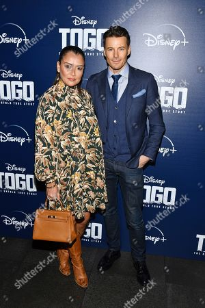 """Keytt Lundqvist, Alex Lundqvist. Keytt Lundqvist and Alex Lundqvist attend a screening of """"Togo"""", hosted by Disney Plus and The Cinema Society, at iPic Theater, in New York"""