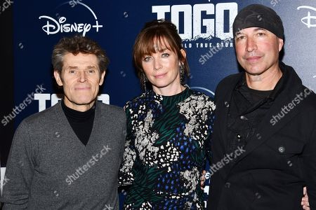 "Willem Dafoe, Julianne Nicholson, Ericson Core. Willem Dafoe, left, Julianne Nicholson and Ericson Core attend a screening of ""Togo"", hosted by Disney Plus and The Cinema Society, at iPic Theater, in New York"